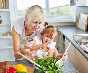 Attractive mother and child cooking