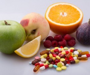 Fruit-piece with the different colorful pills and tablets. Concept what is better. Isolated on white background